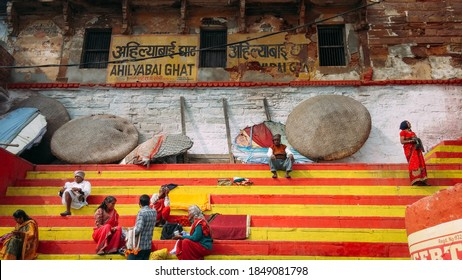 Vranasi, or Benares, Uttar Pradesh, India - Jan 11 2014: Local people taking a rest at Ahilyabai Ghat, the riverfront steps named for Queen Ahilyabai. A destination for religious bathing rituals.
