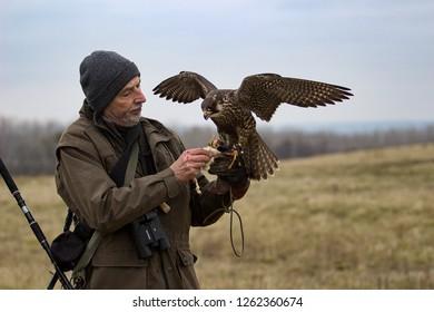 Vranovice, Czech Republic, December 19, 2018, Hunter with falcon