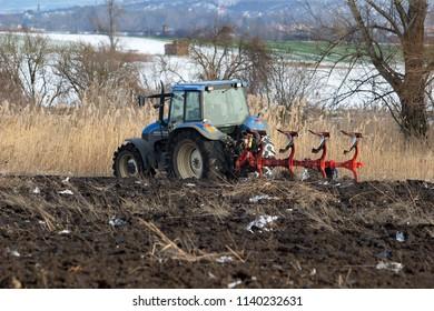 Vranovice, Czech Republic, January 18,2018, Tractor plowing field in winter