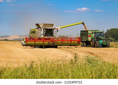 Vranovice, Czech Republic, July 3, 2018, Combine harvestor and tractor on the field