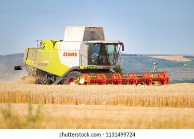 Vranovice, Czech Republic, July 3, 2018, Combine harvestor Claas cuts crop on field