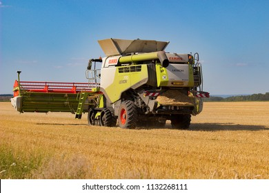 Vranovice, Czech Republic, July 3, 2018, Combine harvester Claas travel over  the field