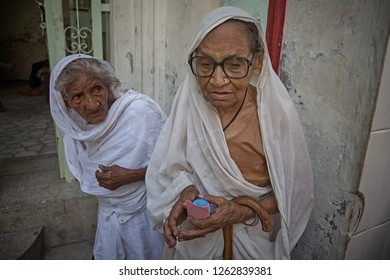 Vrindavan, India, August 2009. Widows in the street next to the entrance of an ashram.