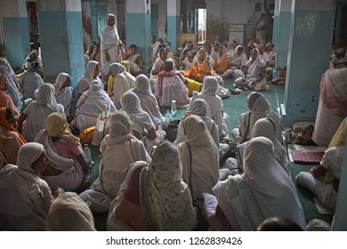 Vrindavan, India, August 2009. Widows gathered to pray inside an ashram.