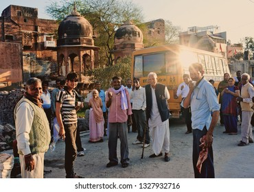 Vrindavan, India - Jul 2018: A big family on the street in holy place of Vrindavan. Indian family look and smile at the camera. Portrait of an Indian family parents with children.