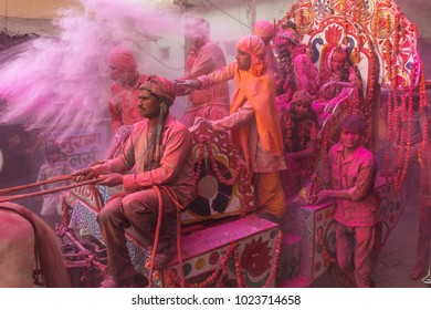 Vrindavan, India - March 19, 2016: Colourful Holi procession on the streets of Vrindavan, Uttar Pradesh, India.