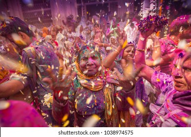 Vrindavan, India - March 27, 2018: An Indian widow celebrating Holi, the Hindu spring festival of colours, at Gopinath Temple in Vrindavan, Uttar Pradesh, India