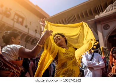 Vrindavan, Mathura, Uttar Pradesh, India - 02/27/2018: Breaking the shackles of tradition, around 800 widows played Holi with gulaal and flowers in the land of lord Krishna, Vrindavan in four-day Holi