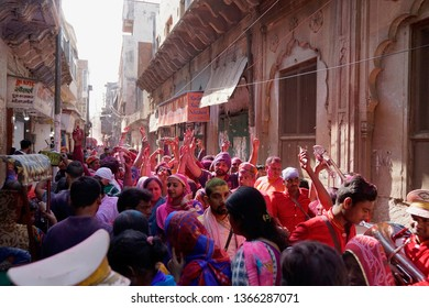 Vrindavan, Mathura, Uttar Pradesh, India - 17 March 2019: People all having fun in town to dance, play and laugh, smear each other with colours and drench each other during Holi Festival.