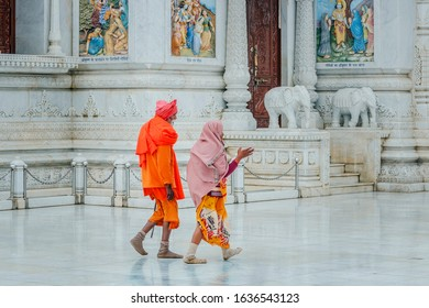 Vrindavan, Mathura, Uttar Pradesh / India - January 5, 2020: An Indian elderly couple of pilgrims go to the Prem Mandir Temple.