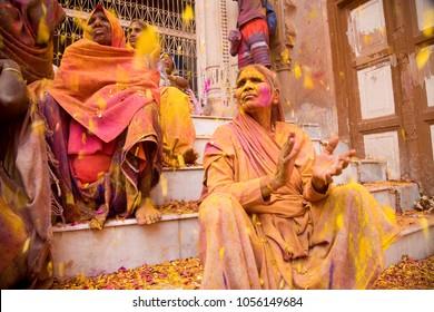 Vrindavan, Uttar Pradesh/India-2 27 2018: Widows participate in Holi celebrations at Vrindavan, Uttar Pradesh, India