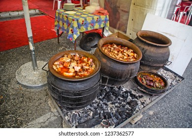"VRSAC, SERBIA - SEPTEMBER 17; 2016 Cooking food in clay pots for the guests of the event, ""Grape harvest - Grape Ball"""
