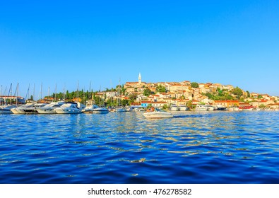 VRSAR, CROATIA- AUGUST 28, 2016: Vrsar Marina and old town on background in summertime. Vrsar is small charming mediterranean town of Croatian coast.