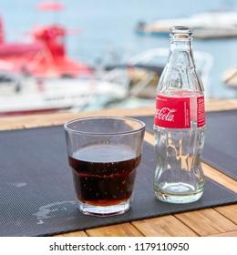 VRSAR, CROATIA – JULY 21, 2018: Coca-Cola bottle and a glass on the table of a beach bar of the city Vrsar in Croatia