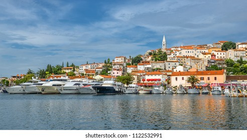 Vrsar, Croatia - May 22, 2018: Coastal town of Vrsar, Istria, Croatia. Vrsar - beautiful antique city, yachts and Adriatic Sea.