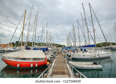 Vrsar, Croatia - May 22, 2018: Harbor with yachts of Coastal town Vrsar, Croatia. Vrsar - beautiful antique city, yachts and Adriatic Sea.