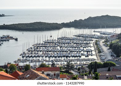 Vrsar, Croatia - May 22, 2018: Top view on yacht, port, Adriatic sea and small Croatian town Vrsar.