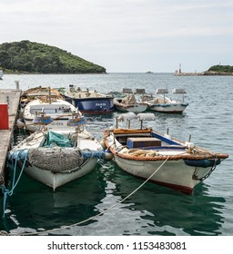 Vrsar, Croatia - May 22, 2018: Yachts, Adriatic Sea and Vrsar - beautiful antique city. Coastal town of Vrsar, Istria, Croatia..