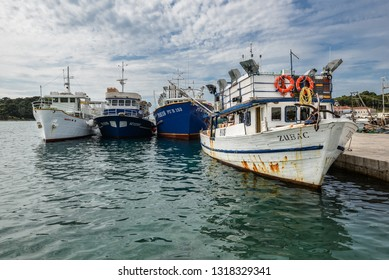 Vrsar, Croatia - May 22, 2018: View on yacht, harbor, Adriatic sea and small Croatian town Vrsar, Croatia