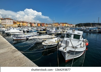 Vrsar, Croatia - May 22, 2018: Pier in coastal town of Vrsar, Istria, Croatia. Vrsar - beautiful antique city, yachts and Adriatic Sea.