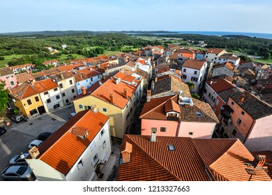 Vrsar, Croatia - May 23, 2018: Coastal town Vrsar, Istria, Croatia. Vrsar - beautiful antique city with bright red roofs.