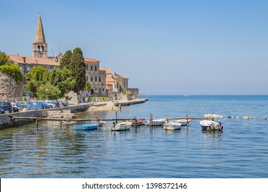 Vrsar, Croatia - September, 2018: Pier in coastal town of Vrsar, Istria, Croatia. Vrsar - beautiful antique city, yachts and Adriatic Sea.