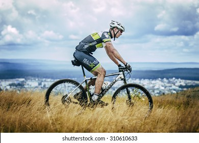 """V.Ufaley, Russia - August 09, 2015: cyclist rides on top of a mountain during race """"Big stone"""", V.Ufaley, Russia - August 09, 2015"""