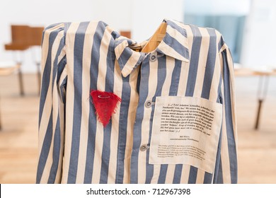 "VUGHT, NETHERLANDS - AUGUST 23, 2017: uniform with red triangle belonging to political prisoner at former concentration camp ""kamp Vught"""