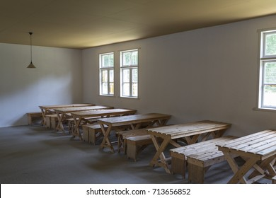 """VUGHT, NETHERLANDS - AUGUST 23, 2017: Dining room in the barracks of former concentration camp """"kamp Vught"""""""