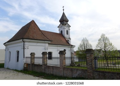 Vukovar Croatia April 7th 2016 Church Saint Roko on the small hill with a fence and tree