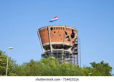VUKOVAR, CROATIA - AUGUST 25, 2017: Water tower in Vukovar, with bullet & missile holes from the 1991-1995 conflict, which opposed Serbian to Croatian forces. The water tower became symbol of the war