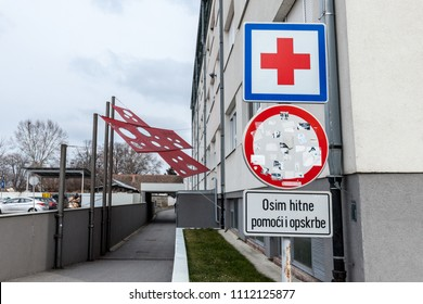 VUKOVAR, CROATIA - FEBRUARY 25, 2018: Entrance of the Vukovar Hospital memorial with its iconic red cross, a memorial dedicated to the massacre that occured there during the Yugoslav War