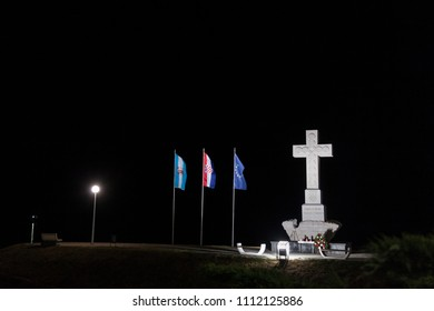 VUKOVAR, CROATIA - MAY 13, 2018: Moument dedicated to the defenders of Vukovar in the Homeland war of 1991-1995, made of a Christian cross with European and Croatian flags