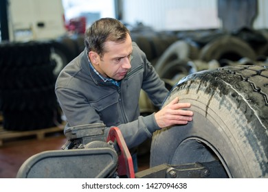 vulcanizing worker searching for the puncture