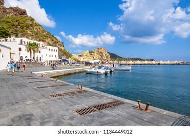 Vulcano Island, Italy - September 9, 2016: People in the port on Vulcano Island, one of the Aeolian Islands in Italy