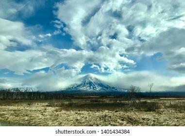 Vulcans under dramatic sky. Kamchatka