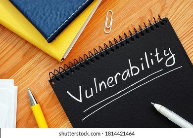 Vulnerability is written in white pencil on a black page.