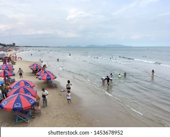 VUNG TAU, VIETNAM - AUGUST 26, 2017: People sun bathe and swim at the front beach. Vung Tau is a weekend sea resort popular with Saigon residents.