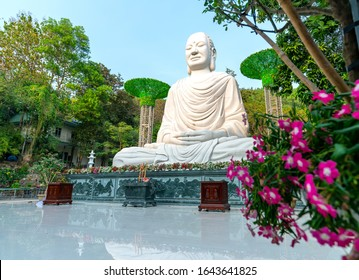 Vung Tau, Vietnam - December 22nd, 2019: Big buddha statue meditating in front of temple yard. This is a place where spirituality prays for everyone to lead a peaceful life in Vung Tau, Vietnam