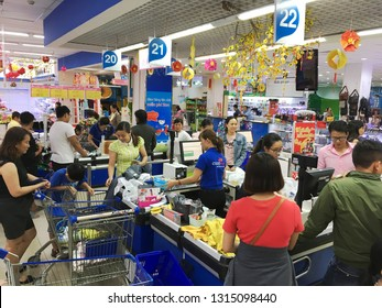 VUNG TAU, VIETNAM - FEBRUARY 14, 2018: A lot of customers queue up a a Coopmart supermarket during Chinese New Year season of discounts.