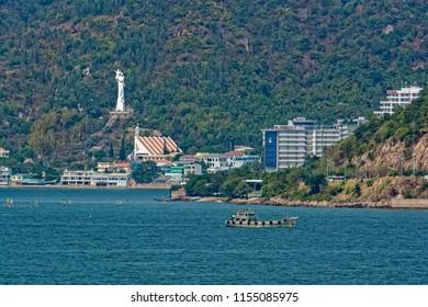 VUNG TAU, VIETNAM - Jan 13, 2018: Catholic Church and Virgin Mary and Baby Jesus Statue, Our Lady of Bai Dau Shrine, on Nui Lon (Big Mountain).