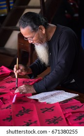 Vung Tau, Vietnam - January 18, 2017: Writing couplets for Spring Festival at Long Son, Vung Tau city. Calligraphy giving is a tradition popular for Spring holiday to Vietnamese People.