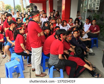 VUNG TAU, VIETNAM - JANUARY 27, 2018: Unidentified young people watch on TV the final of the 2018 AFC U 23 Championship. Uzbekistan defeated Vietnam in the final to win their first title