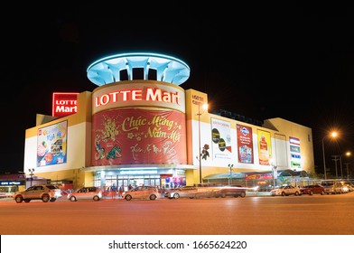VUNG TAU, VIETNAM - JULY 7, 2015: The Lotte Mart supermarket facade at night. Lotte Mart is an east Asian hypermarket that sells a variety of goods, with headquarters in Japan and South Korea.