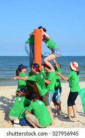 Vung Tau, Vietnam - June 29, 2015. Unidentified young people in the green uniform playing a team sport game on the beach in Vung Tau, southern Vietnam.