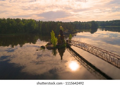The Vuoksa River and the Church of the Apostle Andrew the First-Called in the early June morning (aerial survey). Leningrad region, Russia