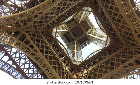 Vview to top of Eiffel tower from under the Paris landmark