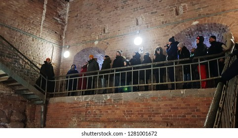 Vyborg, Leningrad region/ Russia- 01.05.2019: Tourists inside  the tower of St. Olaf of Vyborg medieval castle climb the stairs to the observation deck.