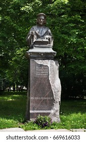 VYBORG. RUSSIA. 28 JUNE 2012 : Monument to Mikael Agricola in front of townhouse in Vyborg. Russia