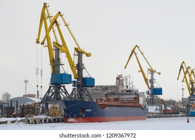 VYBORG, RUSSIA - FEBRUARY 24, 2017: The Kersti freighter (IMO 9342138) on loading in the cargo port of Vyborg cloudy winter